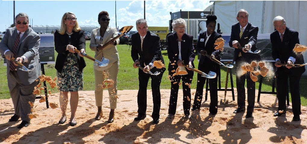 government officials holding shovels at airbus groundbreaking