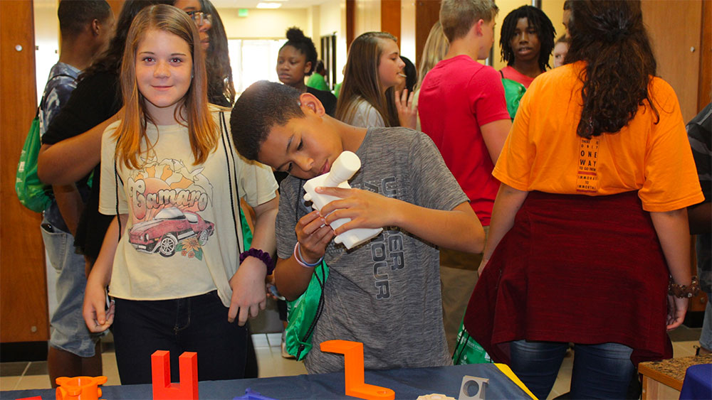 students doing experiment at career discovery event