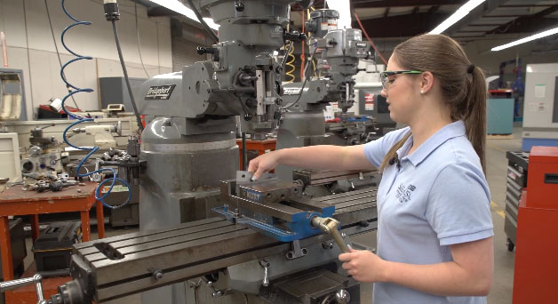 A female student working at a machine