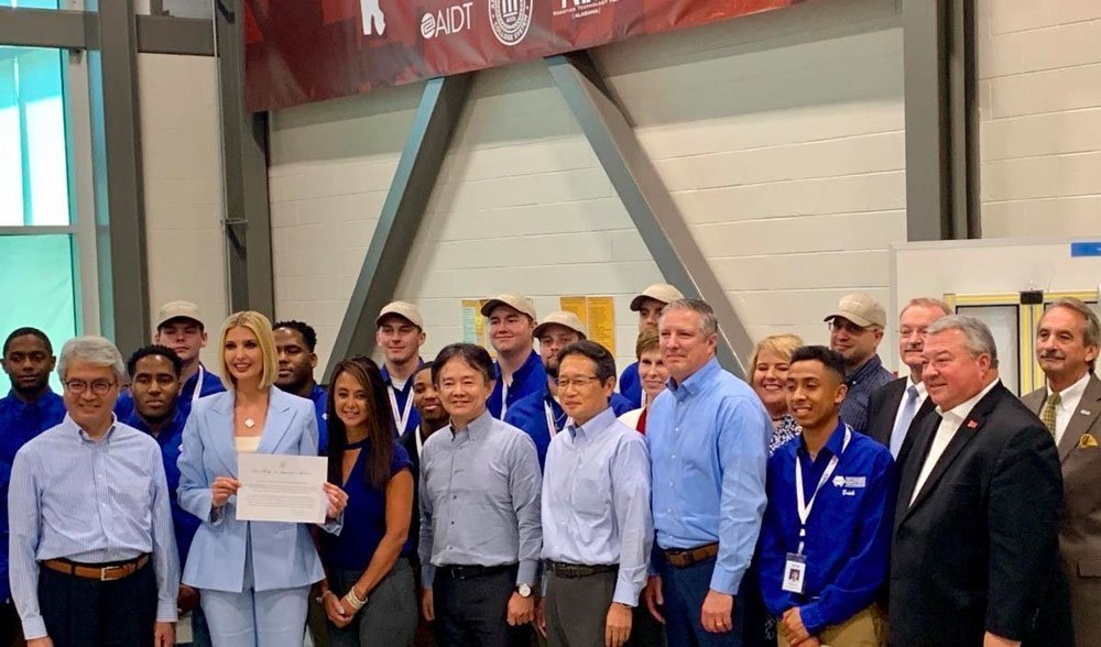 ivanka trump poses for award picture with robotics group