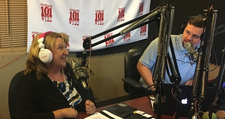 Mikki Ruttan talking on a radio show
