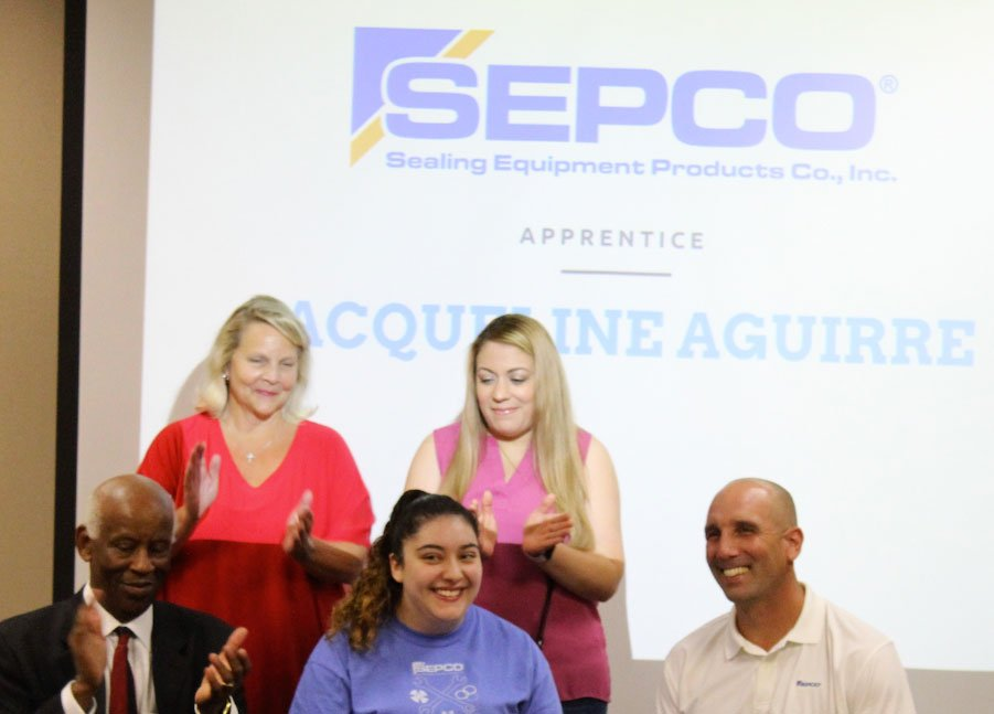 Group posing for picture at signing day for apprentices