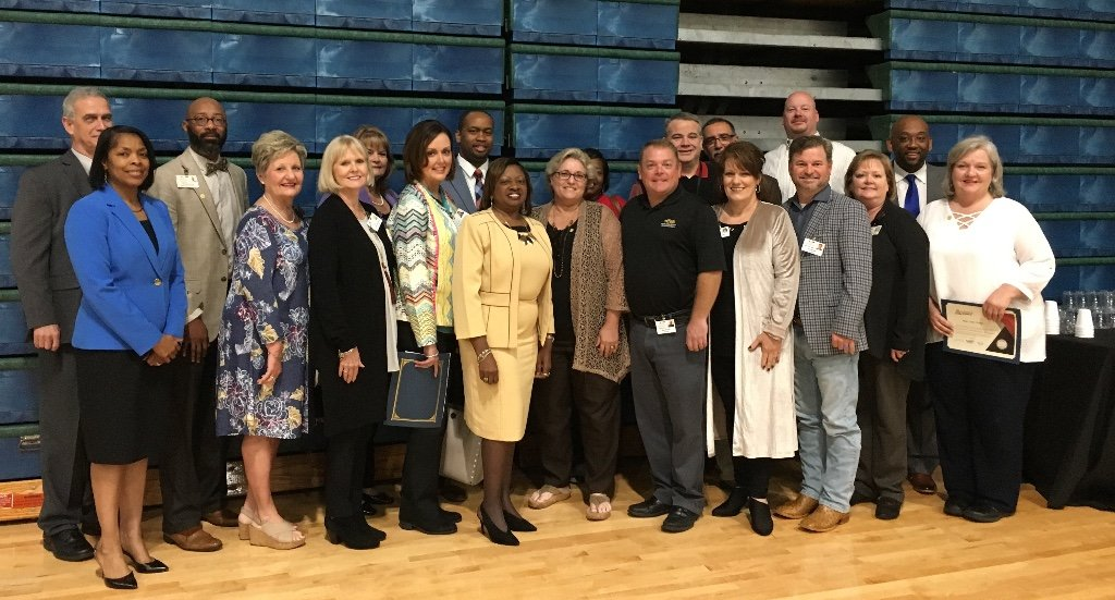 west alabama educators pose for picture