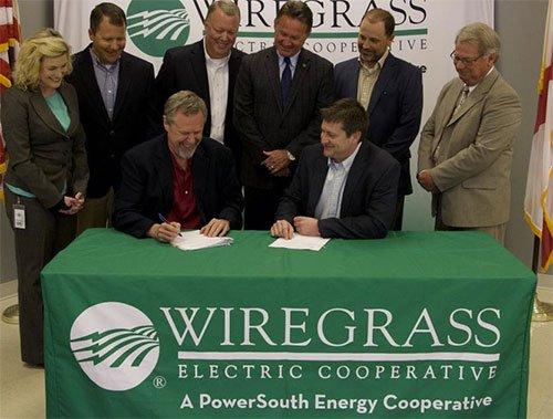 Wiregrass Electric Cooperative signing document